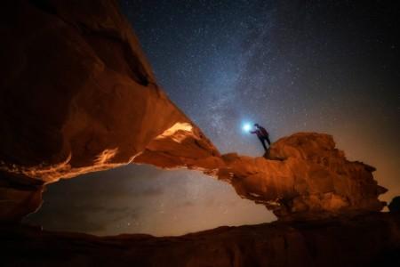 night and star scene of stone arc in wadi rum jordan