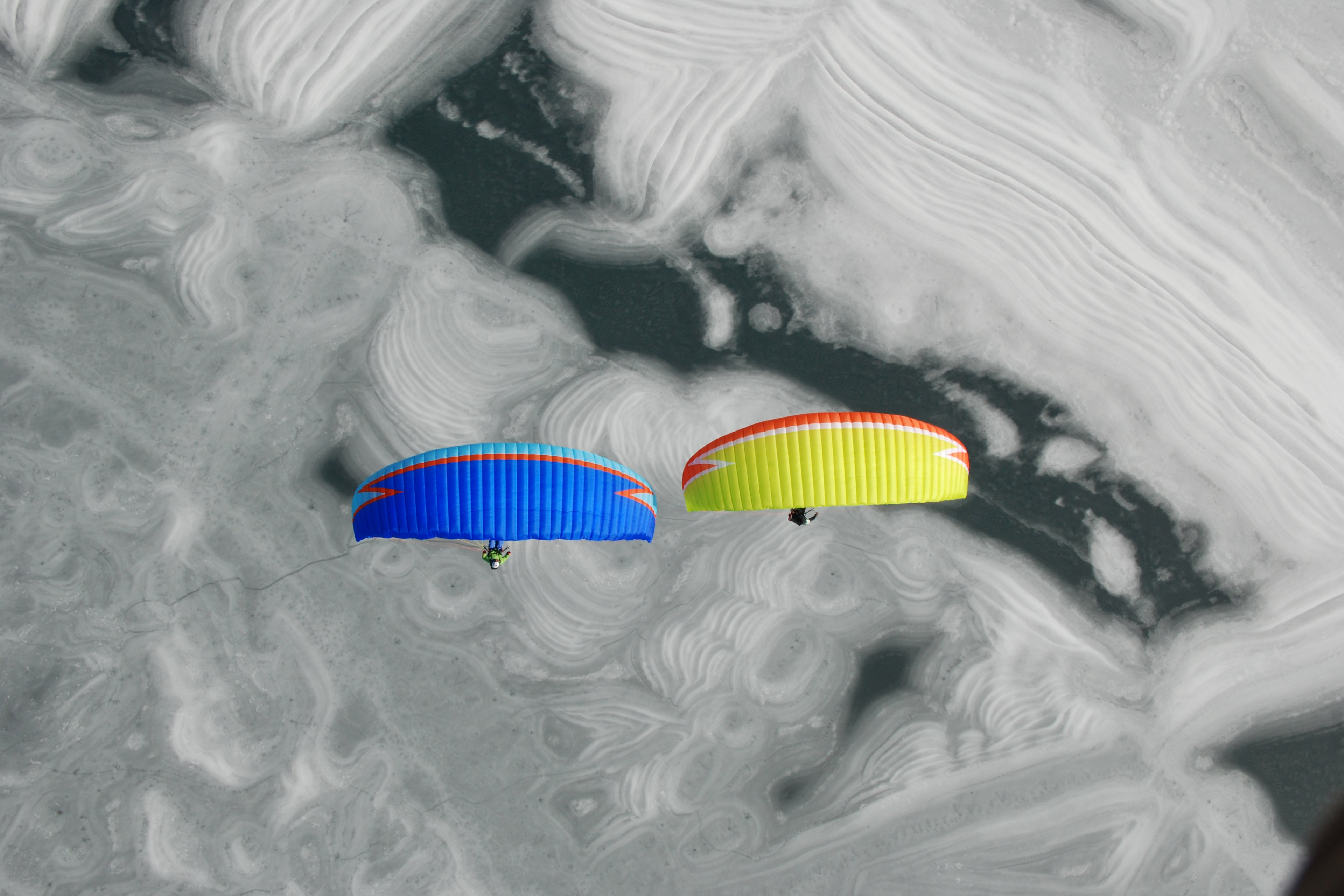 Paragliding above frozen a lake