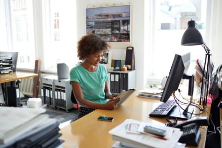 Women sitting at her creative desk