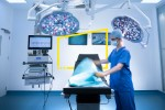 Nurse preparing operating theatre in hospital setting static