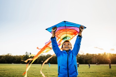 Boy enjoying learning how to fly a kite