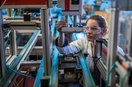 Woman in factory wearing goggles