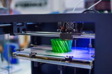 Automatic three dimensional 3D printer machine printing plastic model at modern technology exhibition