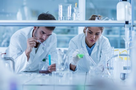 Chemists working scientific research laboratory