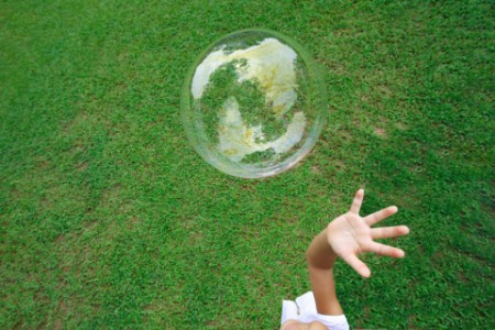 Close-up of a girl reaching for a bubble