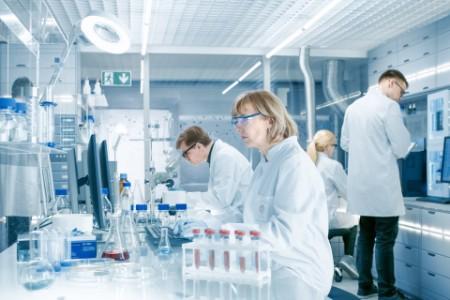Female scientists analyzes liquid