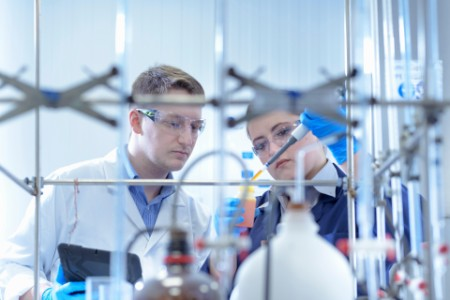 Scientists in laboratory testing chemicals