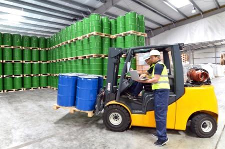 A forklift transporting barrels