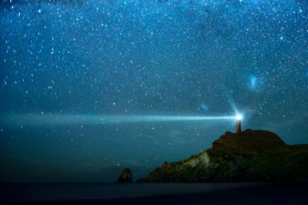 Lighthouse  under milky way stars