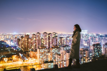 The woman looking over the city
