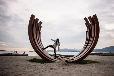 Girl on sculpture on beach