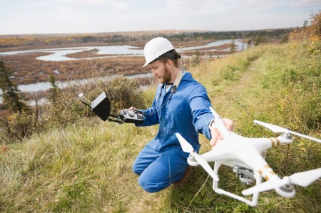 Surveyor with drone equipment on the hillside