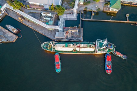 Aerial view of liquefied natural gas tanker loading in port
