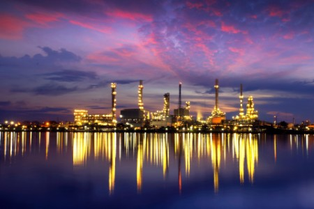 Oil refinery by river thailand night