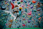 ey-teenage-girl-climbing-an-indoor-bouldering-wall