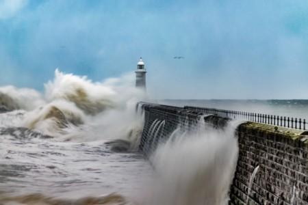 Waves hitting on pier