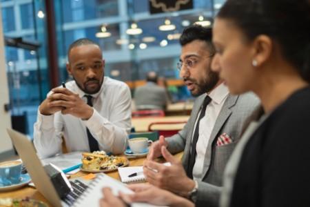 ey-business-people-meeting-working-food
