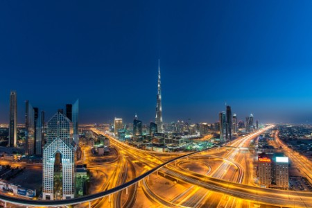 Busy interchange Dubai Burj Khalifa background