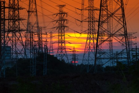 Electricity distribution station and towers at sunset
