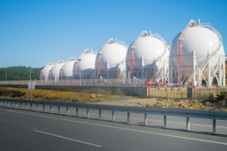 LNG storage tanks on a roadside. Sunny and clear view.