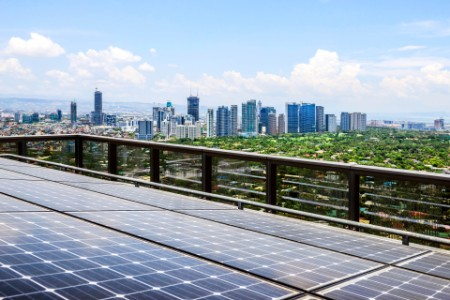 solar panels and manila cityscape under blue sky philippines