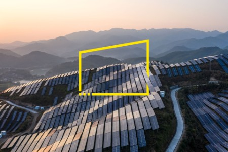 Solar power plant on the top of the mountain at sunset
