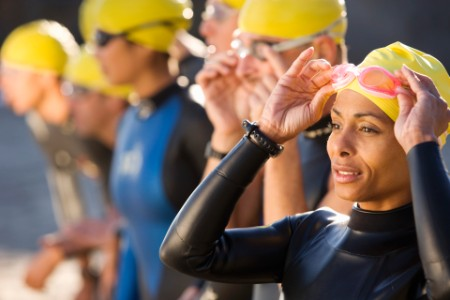 Triathlete Start Race wetsuit yellow hat