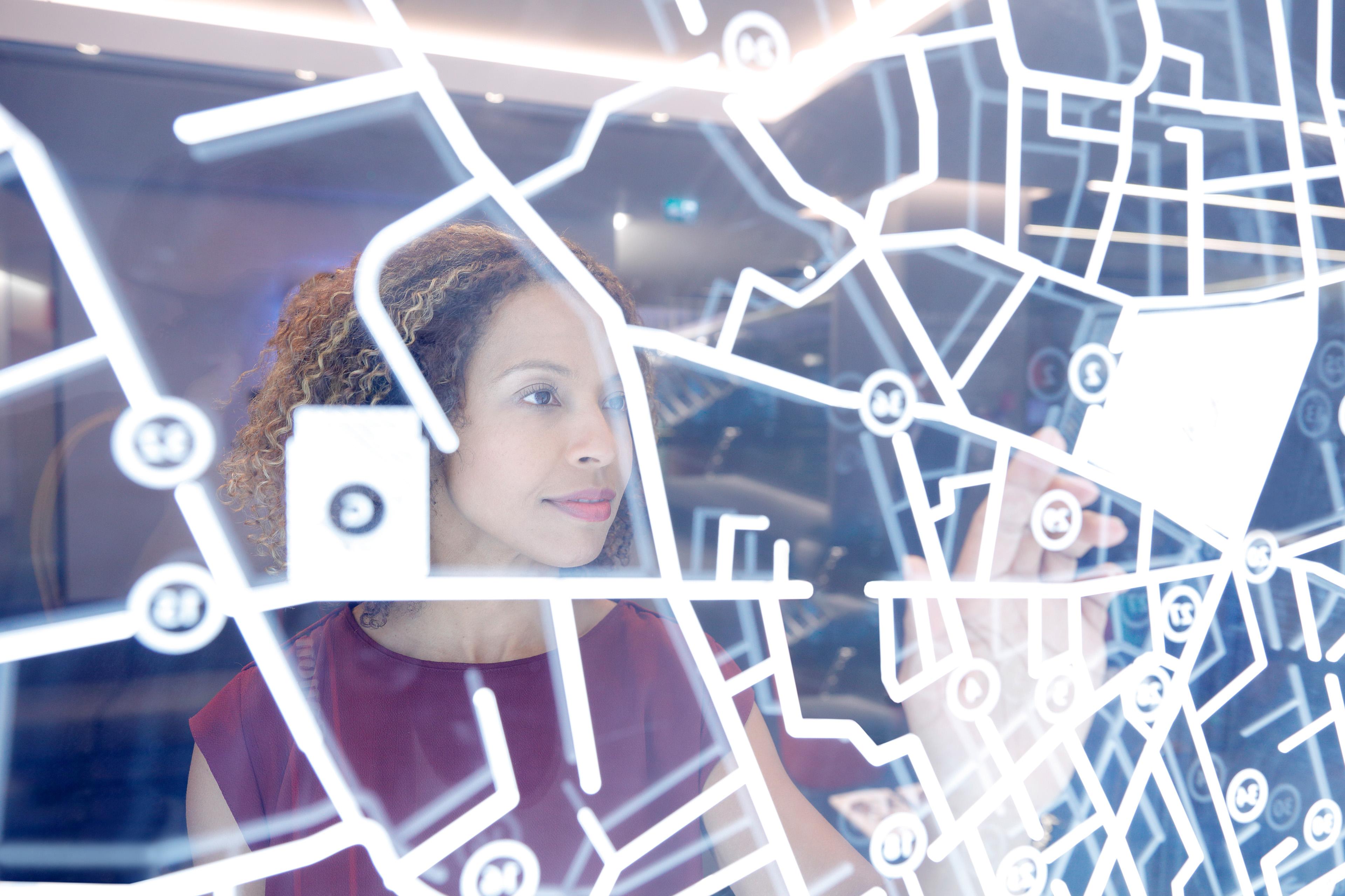 Woman looking at the digital screen