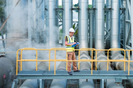 A worker on walkway at power station