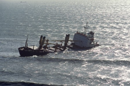 Ship lies half submerged in coastal waters off Whitsand Bay