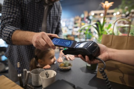 Father daughter paying smartphone contactless