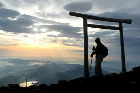 Silhouette man on mount fuji at sunrise