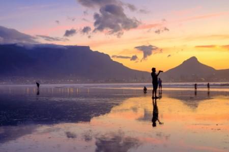 Photographer on lagoon beach milnerton cape town