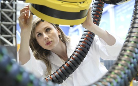 Woman examining a tube device