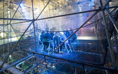 Participants at innovation conference having a meeting in scaffolding.