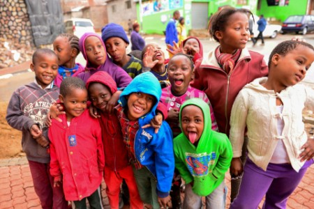 Children pose Alexandra township South Africa