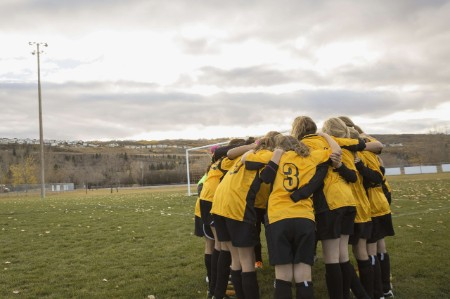 female sports team huddle discuss strategy game
