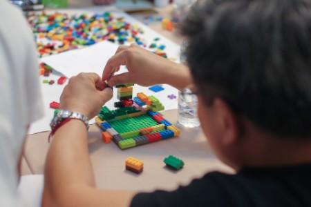 man building colored blocks