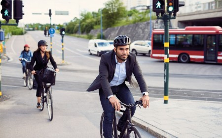 A man wearing a suit cycling