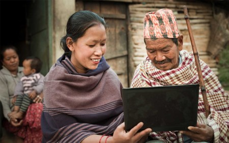 nepalese woman showing laptop senior man