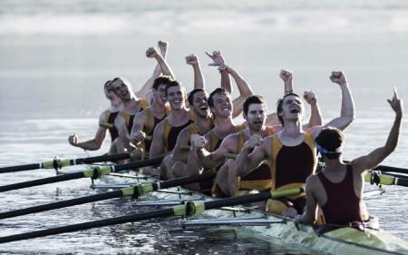 Rowing team winning race