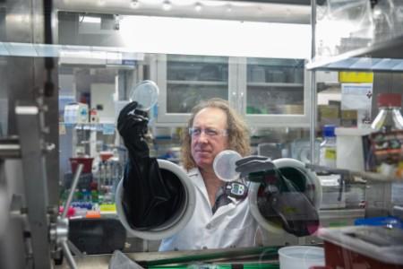 Sean Simpson examines samples in the lab