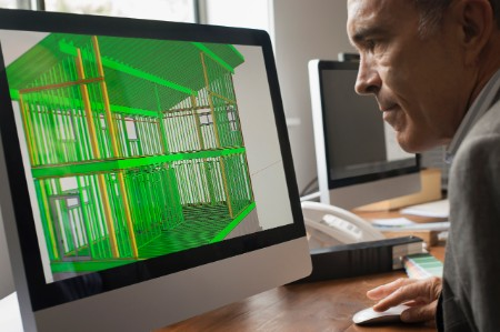 An architect uses a computer to design a building.