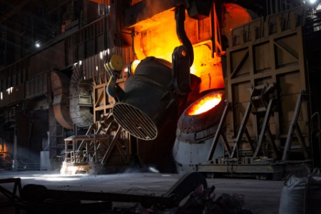 A bucket tilts over a furnace mouth at bsl scunthorpe plant