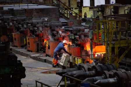Steel workers ensuring defect-free production