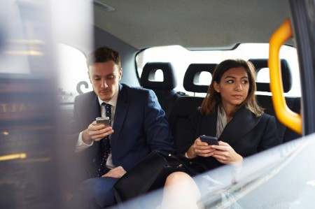 Businesspeople Travelling Taxi