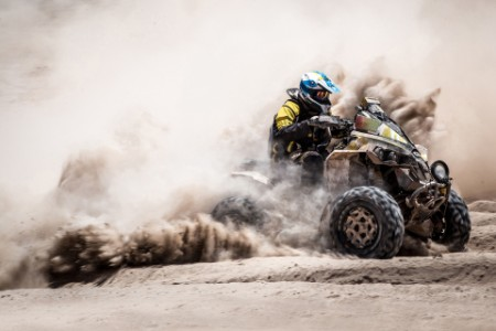 A quad biker performing during a competition
