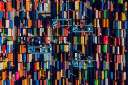Aerial perspective of containers arranged inport