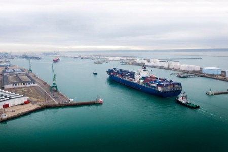 Aerial view of containers ship arriving in havre port