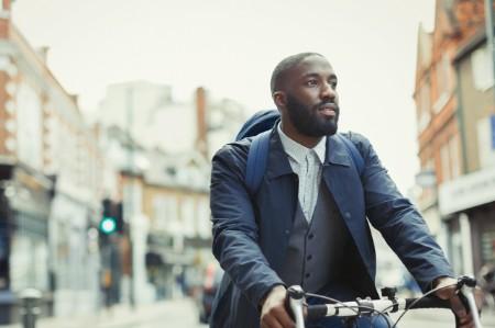 Businessman commuting bicycle urban street